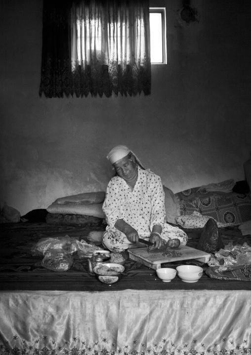 Woman Preparing Food In Her Home, Keriya, Old Town, Xinjiang Uyghur Autonomous Region, China