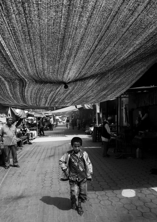 Young Boy Walking Hin The Covered Market, Keriya, Xinjiang Uyghur Autonomous Region, China