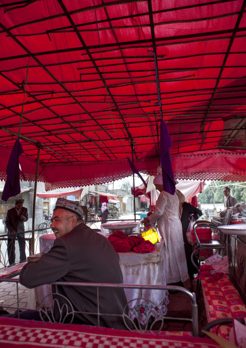 Man Sitted In Open-air Restaurant, Keriya, Xinjiang Uyghur Autonomous Region, China