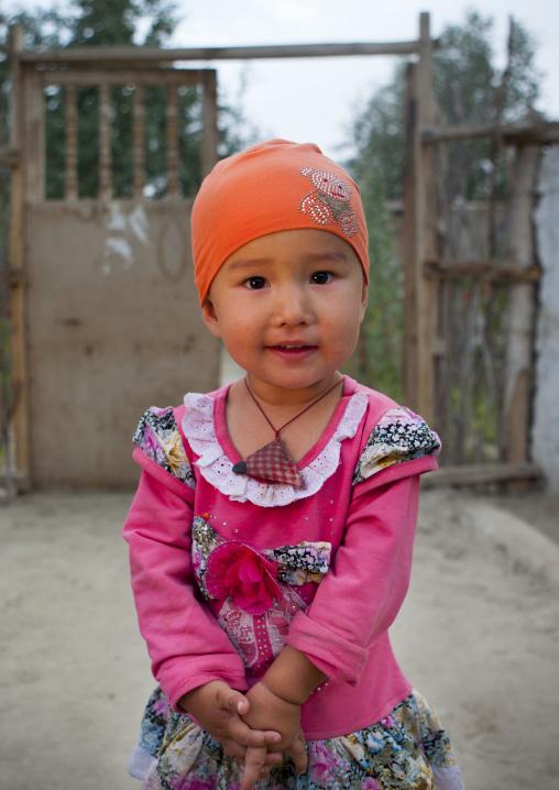 Young Uyghur Girl, Minfeng, Xinjiang Uyghur Autonomous Region, China