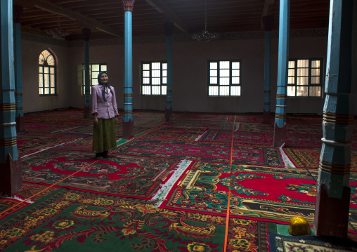 Uyghur Woman Standing Inside Of A Mosque, Minfeng, Xinjiang Uyghur Autonomous Region, China
