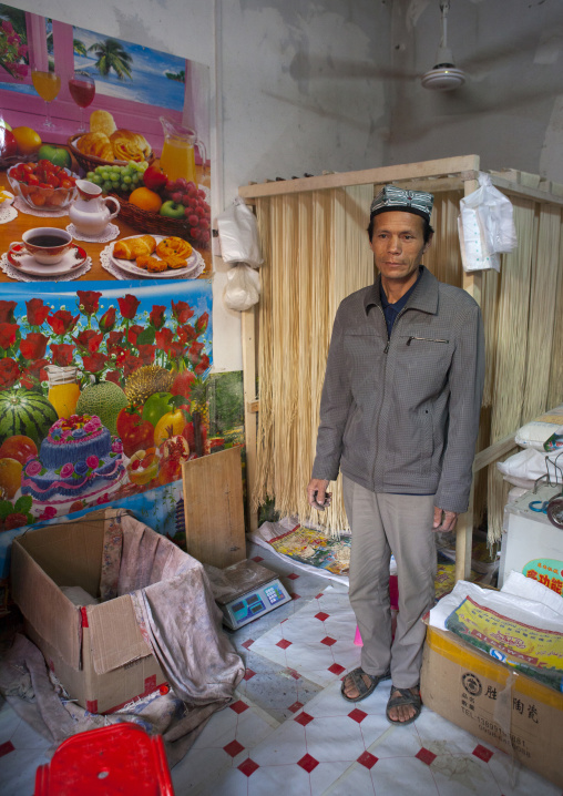 Drying Laghman In A Shop And Uyghur Shopkeeper, Minfeng, Xinjiang Uyghur Autonomous Region, China