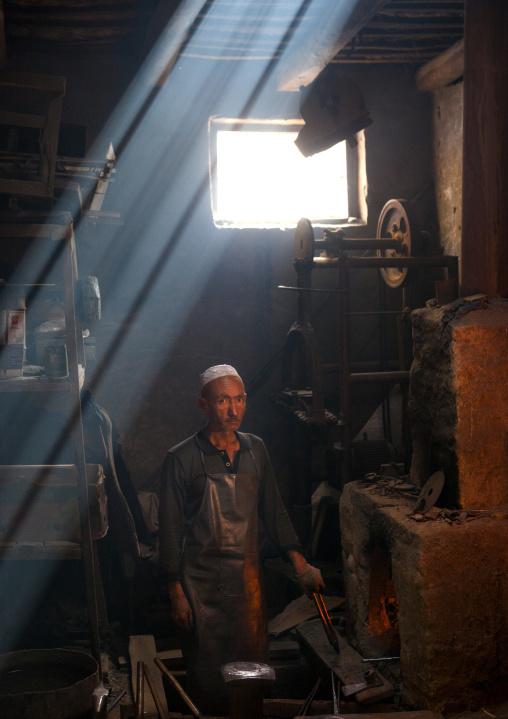 Blacksmith In His Workshop, Xinjiang Uyghur Autonomous Region, China