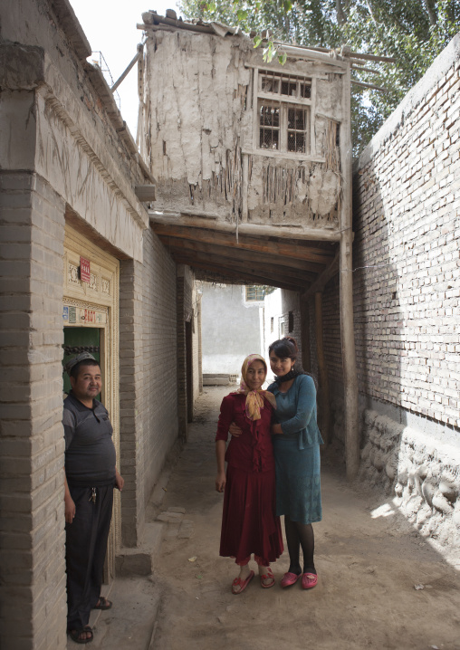 Uyghur Family In A Street Of Minfeng, Xinjiang Uyghur Autonomous Region, China