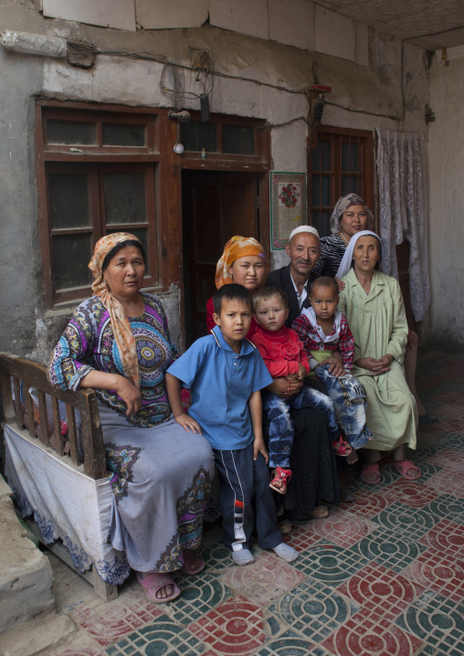 Uyghur Family Outside Their House, Minfeng, Xinjiang Uyghur Autonomous Region, China