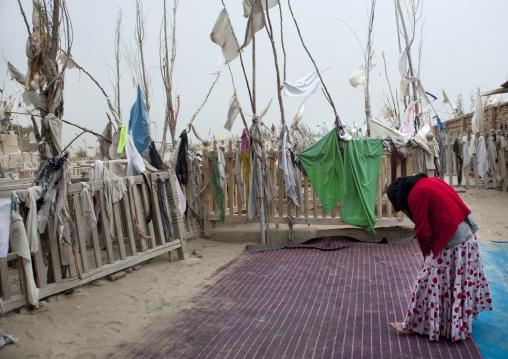 Woman Praying At Imam Asim Tomb In The Taklamakan Desert, Xinjiang Uyghur Autonomous Region, China
