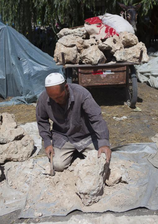 Uyghur Man Preparing Blocks Of Salt,  Yecheng, Xinjiang Uyghur Autonomous Region, China