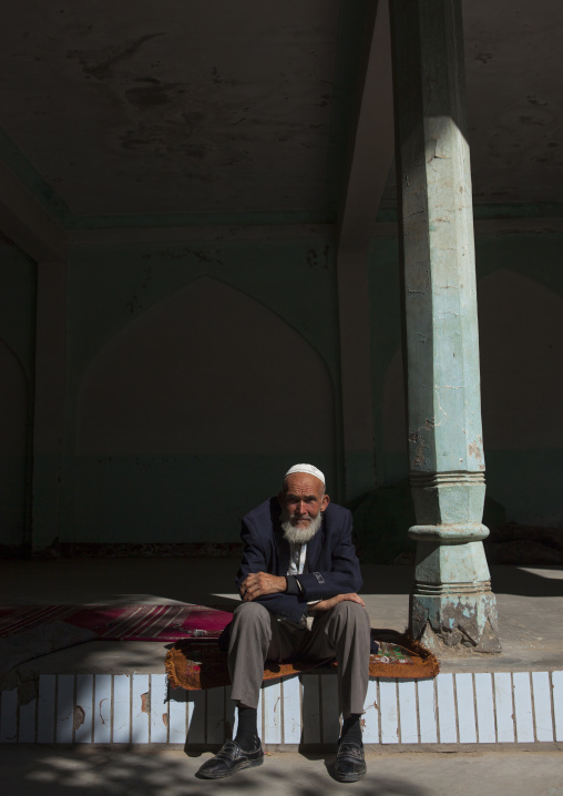 Old Uyghur Man Resting Outside The Mosque, Yarkand, Xinjiang Uyghur Autonomous Region, China