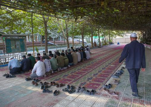 Men Praying Under A Pergola In Mosque, Yarkand, Xinjiang Uyghur Autonomous Region, China