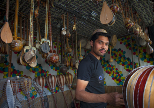 Young Uyghur Man Selling Music Instruments, Yarkand, Xinjiang Uyghur Autonomous Region, China