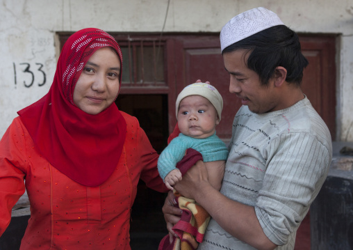 Uyghur Couple And Newborn Baby, Yarkand, Xinjiang Uyghur Autonomous Region, China