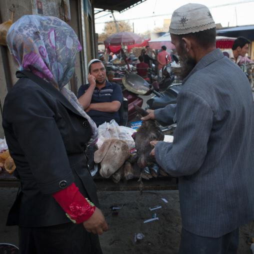 Uyghur Couple Chosing A Mutton Head, Yarkand, Xinjiang Uyghur Autonomous Region, China
