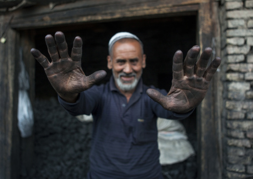 Uyghur Men Selling Coal Showing His Hands Covered By Dust, Yarkand, Xinjiang Uyghur Autonomous Region, China