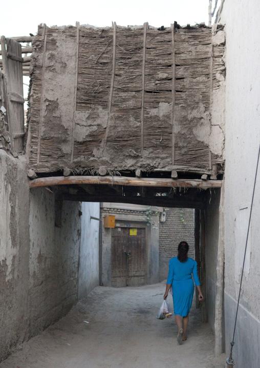 Uyghur Woman Walking In The Street, Yarkand, Xinjiang Uyghur Autonomous Region, China