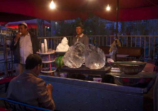 Uyghur Men Eating Ice Cream, Yarkand, Xinjiang Uyghur Autonomous Region, China