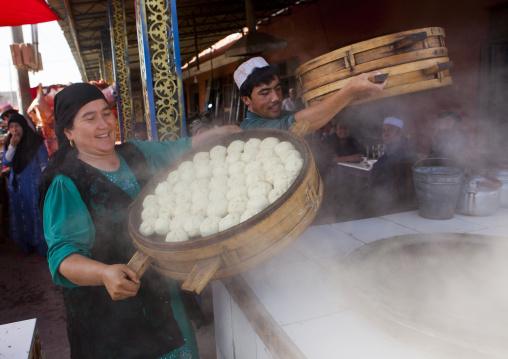 Uyghur Man And Woman Making Dumplings In Serik Buya Market, Yarkand, Xinjiang Uyghur Autonomous Region, China