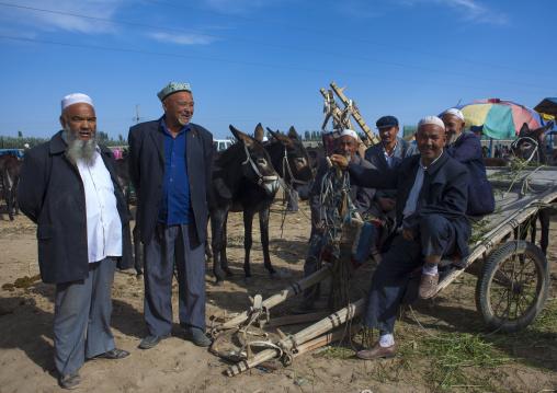 Uyghur Men In Serik Buya Market, Yarkand, Xinjiang Uyghur Autonomous Region, China