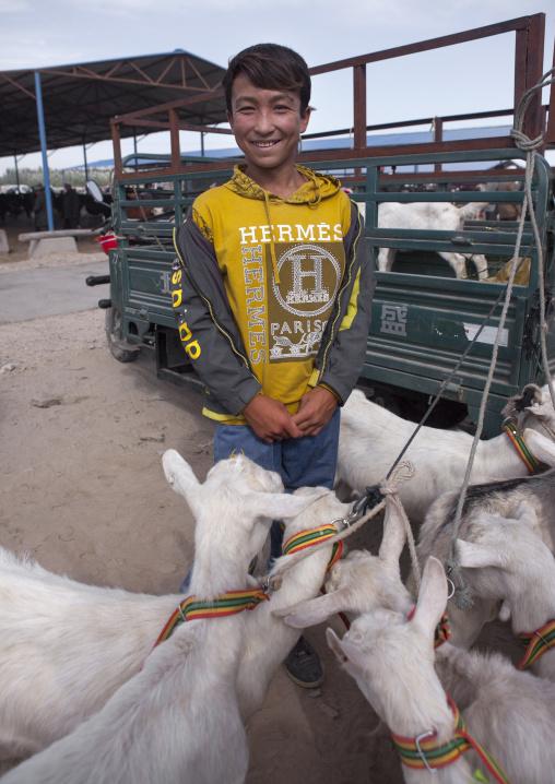 Uyghur Boy And Goats, Serik Buya Market, Yarkand, Xinjiang Uyghur Autonomous Region, China