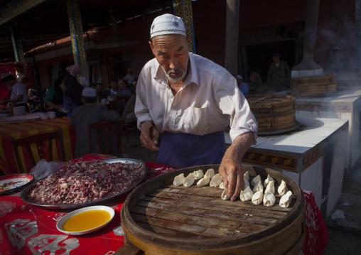 Uyghur Man Making Dumplings, Serik Buya Market, Yarkand, Xinjiang Uyghur Autonomous Region, China