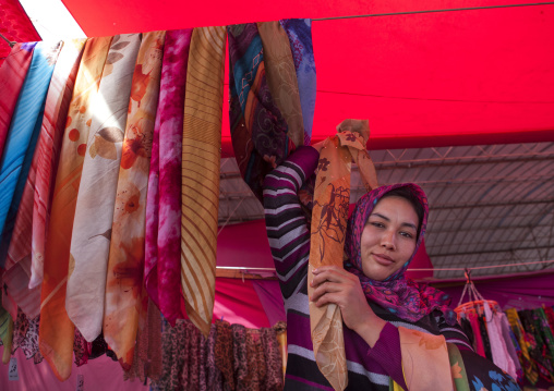 Young Uyghur Woman Selling Scarfs, Serik Buya Market, Yarkand, Xinjiang Uyghur Autonomous Region, China