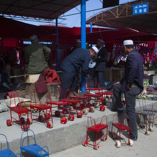 Chairs With Wheels To Harvest Cotton, Serik Buya Market, Yarkand, Xinjiang Uyghur Autonomous Region, China