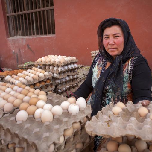 Uyghur Woman Selling Eggs, Serik Buya Market, Yarkand, Xinjiang Uyghur Autonomous Region, China