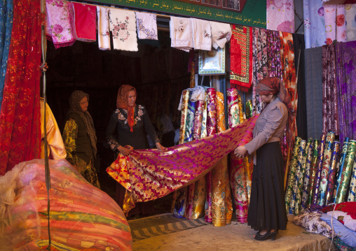 Uyghur Women Choosing Cloth In Serik Buya Market, Yarkand, Xinjiang Uyghur Autonomous Region, China
