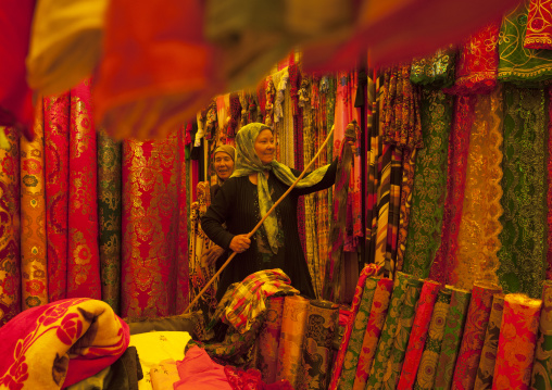 Uyghur Women Chsing Cloth In Serik Buya Market, Yarkand, Xinjiang Uyghur Autonomous Region, China