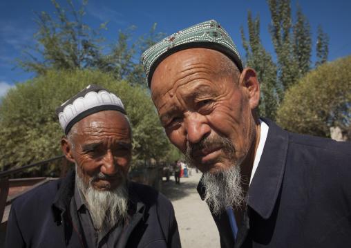 Old Uyghur Men In Serik Buya Market, Yarkand, Xinjiang Uyghur Autonomous Region, China