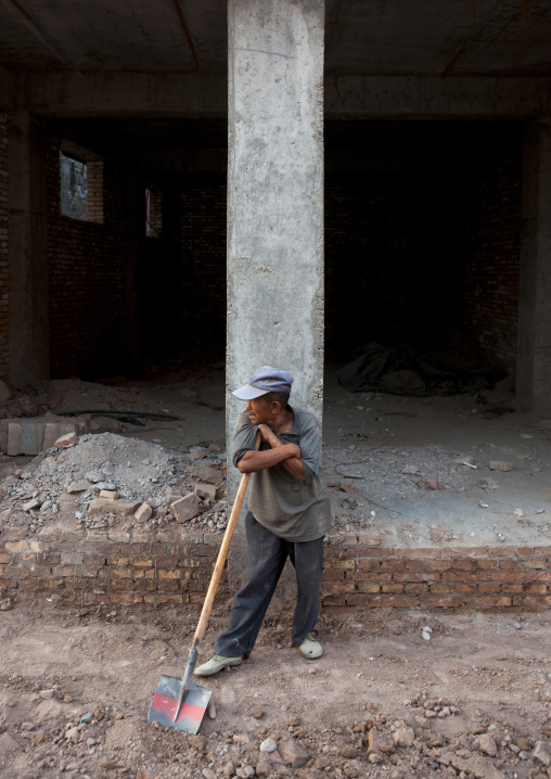 Worker On A Construction Site in the old town, Kashgar, Xinjiang Uyghur Autonomous Region, China