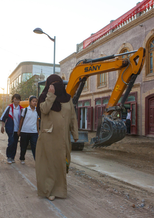 Women Passing By A Construction Site in the old town, Kashgar, Xinjiang Uyghur Autonomous Region, China