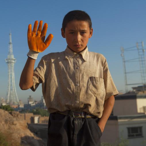 Uyghur Boy waving his hand, Xinjiang Uyghur Autonomous Region, China