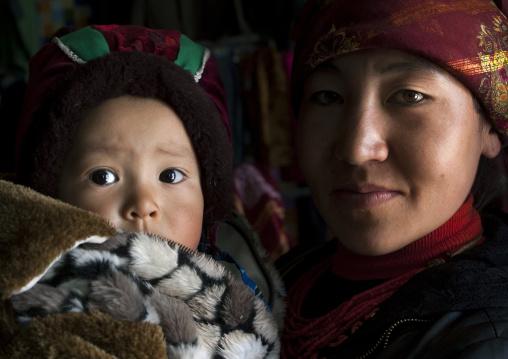 Kyrgyz Mother And Her Child Near Karakul Lake, Xinjiang Uyghur Autonomous Region, China