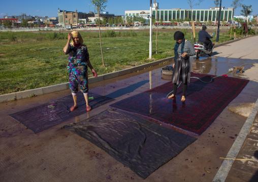 Uyghur Women Cleaning Carpets In Old Town Of Kashgar, Xinjiang Uyghur Autonomous Region, China