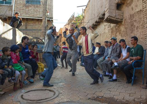 Men dancing in the street during a Wedding In Uyghur Family, Kashgar, Xinjiang Uyghur Autonomous Region, China