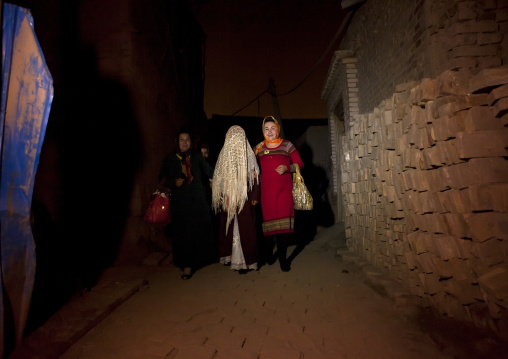 Bride in the street during A Wedding In Uyghur Family, Kashar, Xinjiang Uyghur Autonomous Region, China