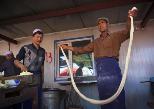 Uyghur Man Making Fresh Laghman Noodles In Kashgar Animal Market, Xinjiang Uyghur Autonomous Region, China