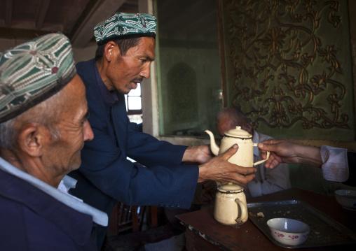 Uyghur Men In Ostangboyi Tea House, Kashgar, Xinjiang Uyghur Autonomous Region, China