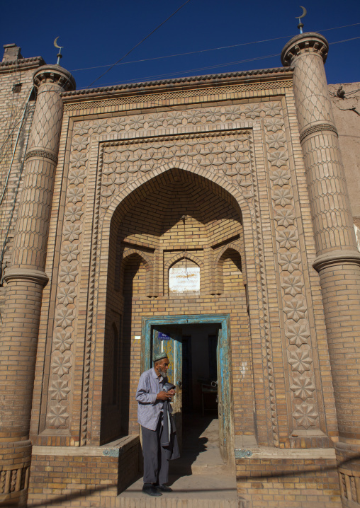 Uyghur Man At The Entrance Of A Mosque, Kashgar, Xinjiang Uyghur Autonomous Region, China