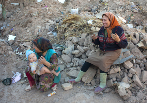 Women And Kid In The Rubbles, Old Town Of Kashgar, Xinjiang Uyghur Autonomous Region, China