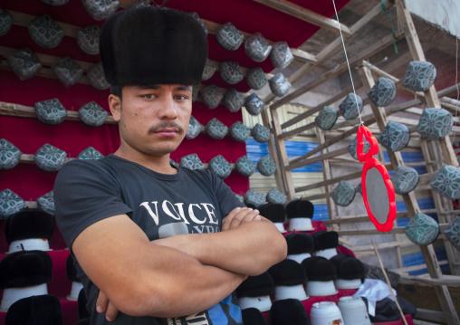 Young Man Selling Doppi Muslim Hats, Opal Village Market, Xinjiang Uyghur Autonomous Region, China