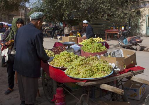 Man Selling Grapes, Kashgar,  Xinjiang Uyghur Autonomous Region, China