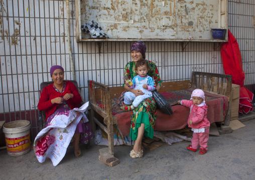 Uyghur Family in the street, Kashgar, Xinjiang Uyghur Autonomous Region, China