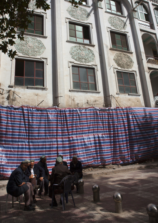 Old Uyghur Men Chatting In Front Of An Old Building, Kashgar, Xinjiang Uyghur Autonomous Region, China