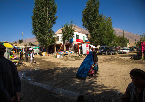 Woman in burka passing in the market street, Badakhshan province, Ishkashim, Afghanistan