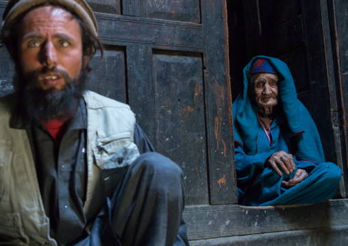 Afghan man with his old mother in a pamiri house, Badakhshan province, Qazi deh, Afghanistan