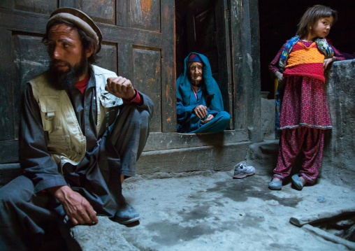 Afghan man with his old mother and his daughter in a pamiri house, Badakhshan province, Qazi deh, Afghanistan