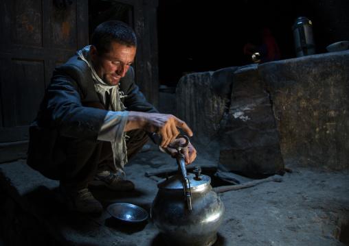 Afghan man cooking in a pamiri house, Badakhshan province, Qazi deh, Afghanistan