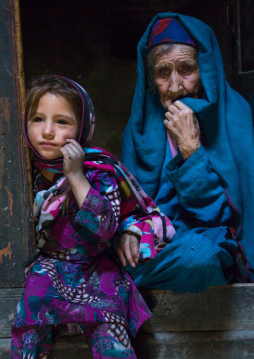 Portrait of an afghan girl with her grand mother in a pamiri house, Badakhshan province, Qazi deh, Afghanistan
