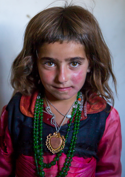 Portrait of an afghan girl with red cheecks, Badakhshan province, Khandood, Afghanistan